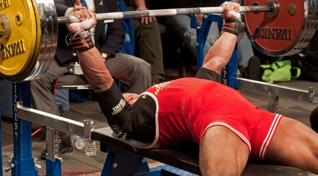 Man about to perform the bench press in competition.