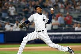Aroldis Chapman in the middle of his pitching motion.
