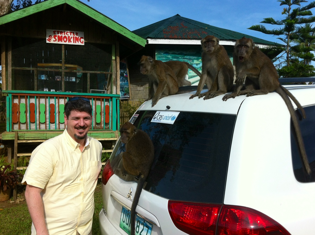Mike Kinsella (MBA) poses beside the monkeys that have taken over the CRS vehicle.