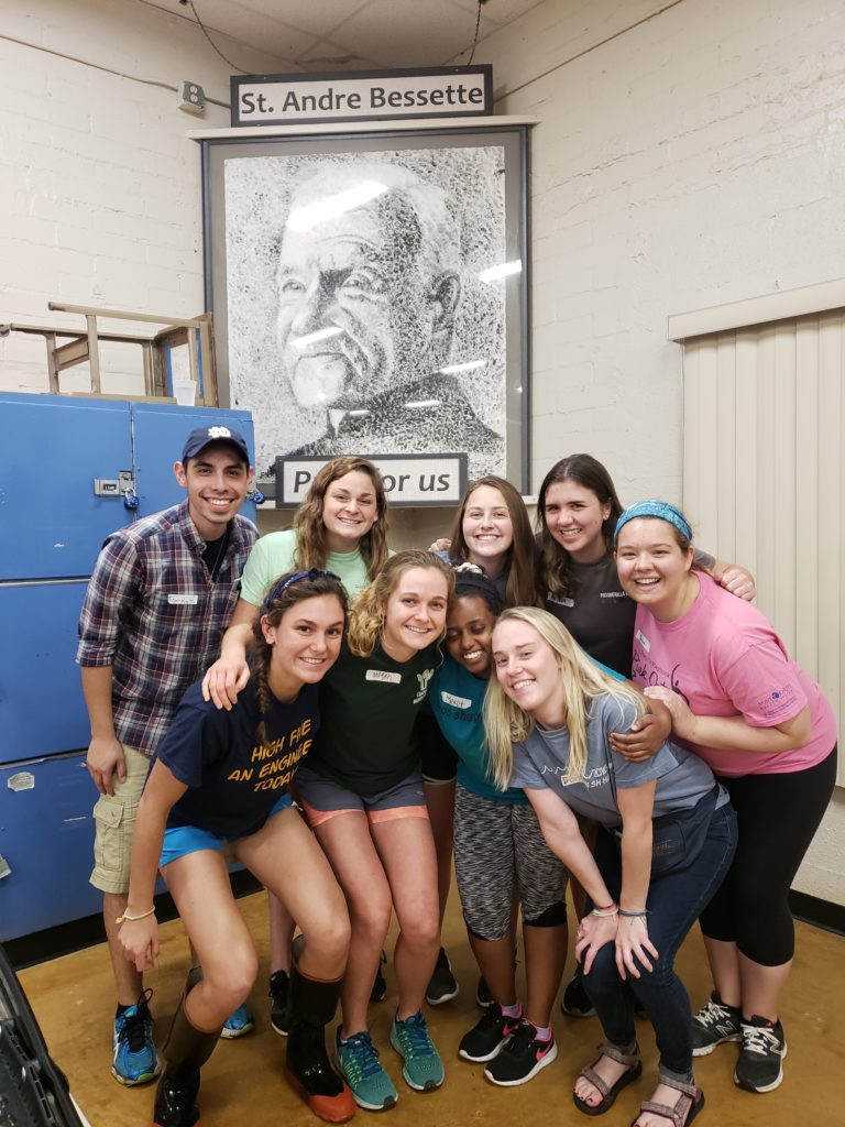 Notre Dame's fall break group pictured with an image of St. André Bessette.