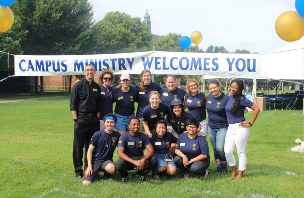"""The Campus Ministry Anchor Interns engaged in hospitality during Welcome Weekend. In the Holy Cross tradition in the charism of hospitality, """"The measure of our generosity will be the sincerity, the simplicity and the sensitivity of our welcome."""" (Constitution 4, Constitutions of the Congregation of the Holy Cross)"""