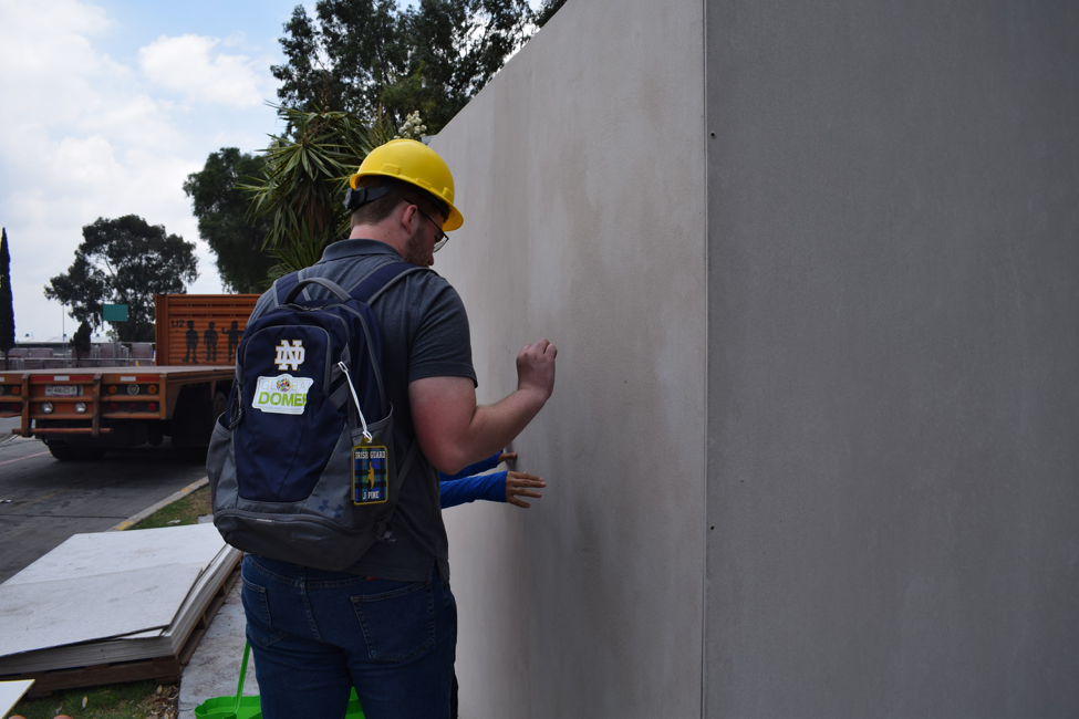 Joshua Pine stands by a fiber cement sample house in Mexico City.