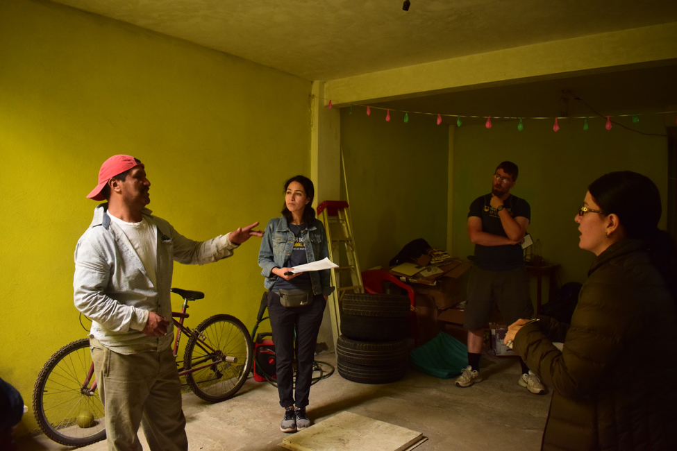 Joshua Pine visits a household to conduct interviews about housing in Tláhua, Mexico.