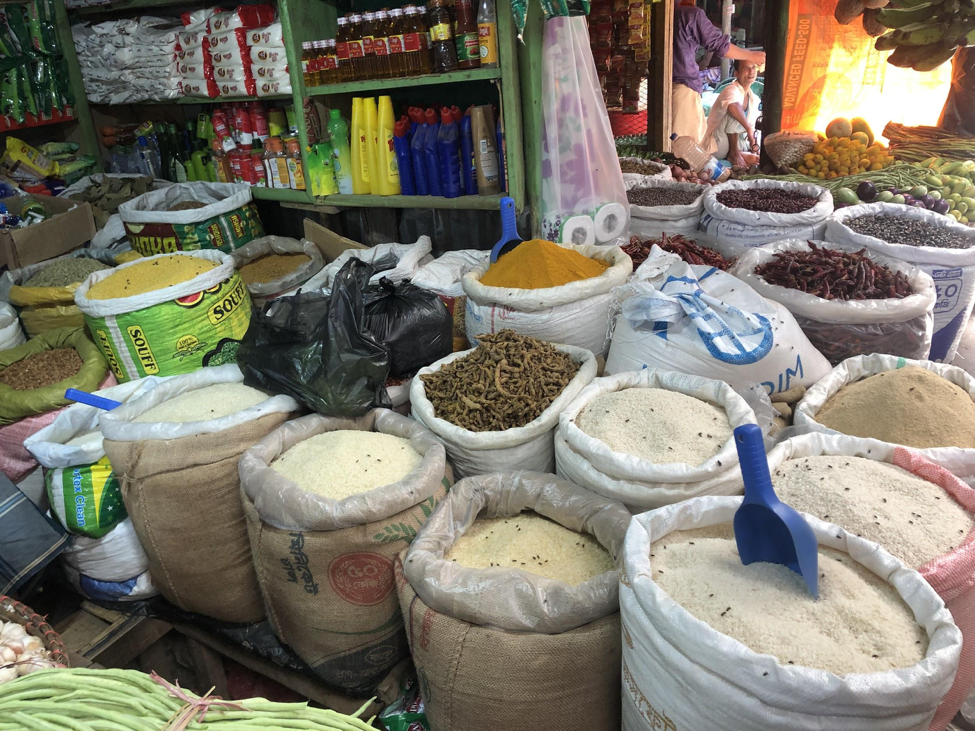 Rows of colorful spices in a local market in Ukhiya, Bangladesh.