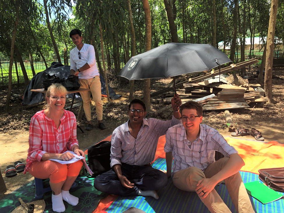 Christine and her research team gather for a meeting outside.