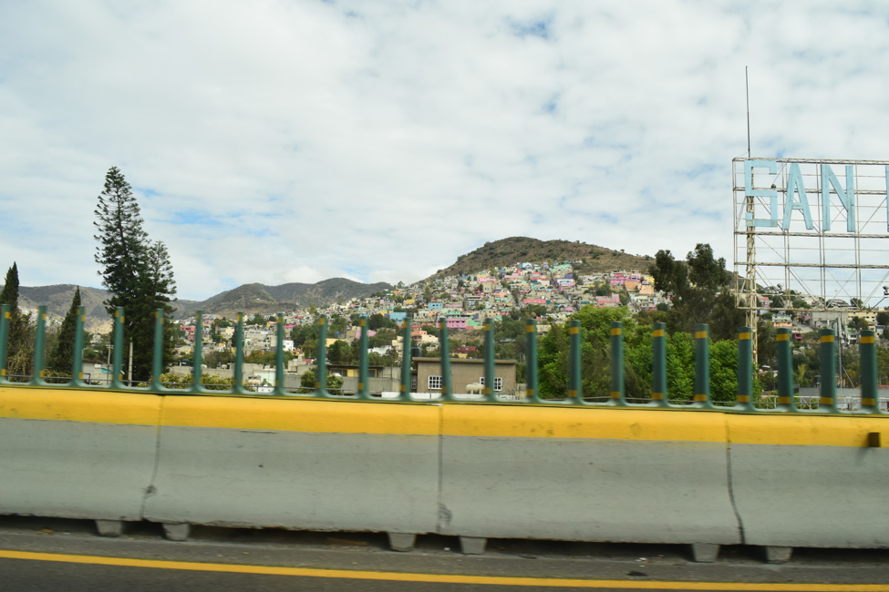 Colorful houses dot a hill on the outskirts of Mexico City.
