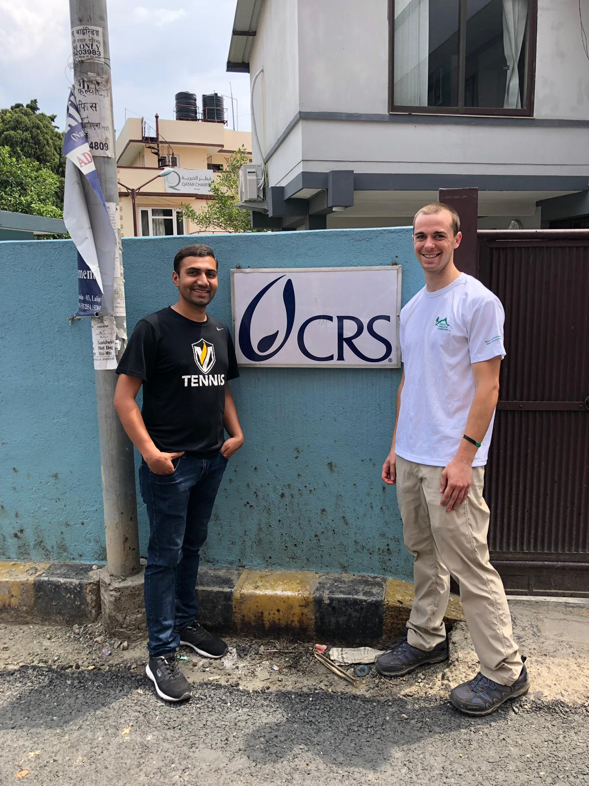 Ramchandra and Brian Hickey, a Notre Dame graduate student, standing in front of a Catholic Relief Services building in Nepal.