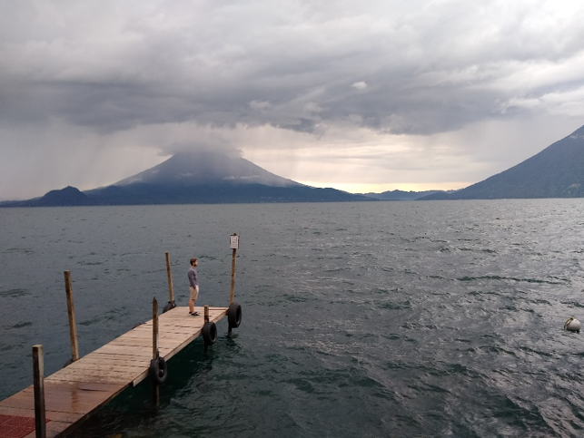 MGA student Dominic Scarcelli waiting to catch a boat on Lake Atitlán, Guatemala