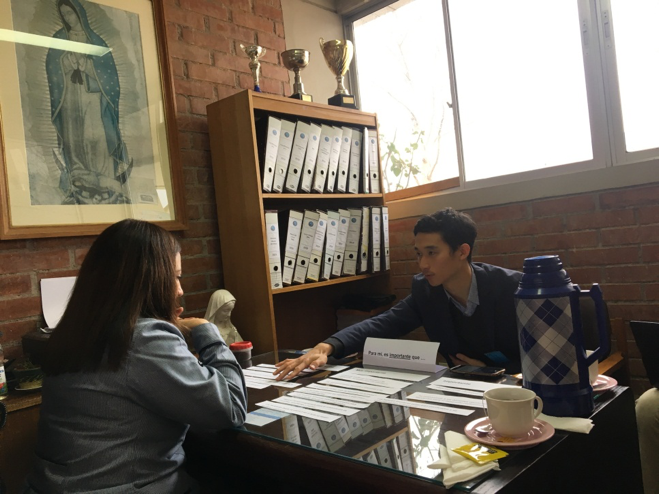 MGA student Seiko Kanda interviews leadership in an administrative office of a public school in Santiago, Chile.