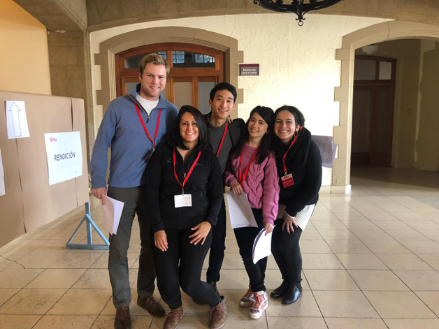 MGA students pose with their partner organizations in an education building in Santiago, Chile.