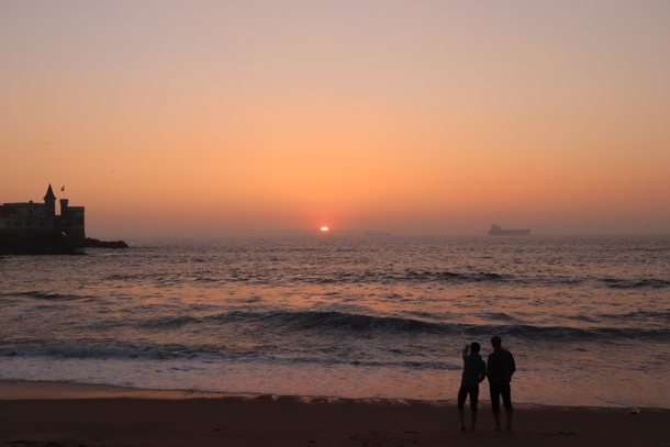 An orange sunset on a beach in Viña del Mar.