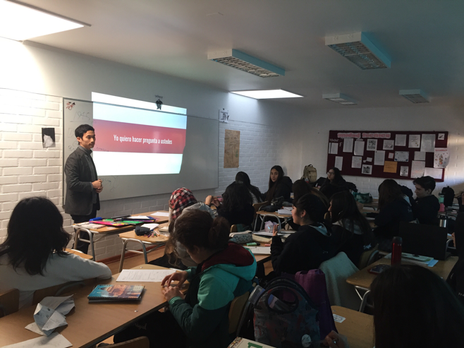 MGA student Seiko Kanda gives a Powerpoint presentation to a classroom of K-10 students in Chile.