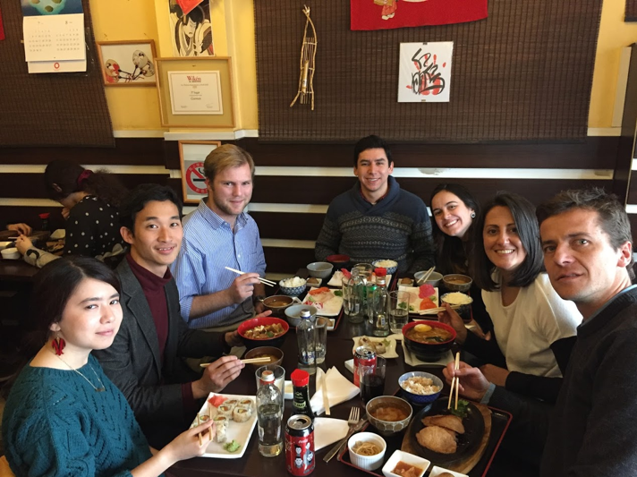 MGA students and representatives from Enseña Chile share Japanese cuisine at a restaurant in Chile.