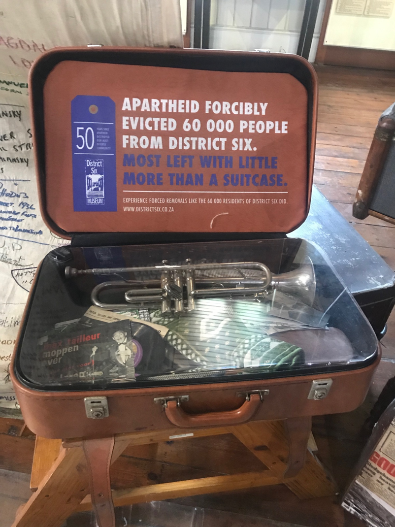 Dsitrict Six Suitcase, an example of the research into links between structural violence, inequality, and transitional justice
