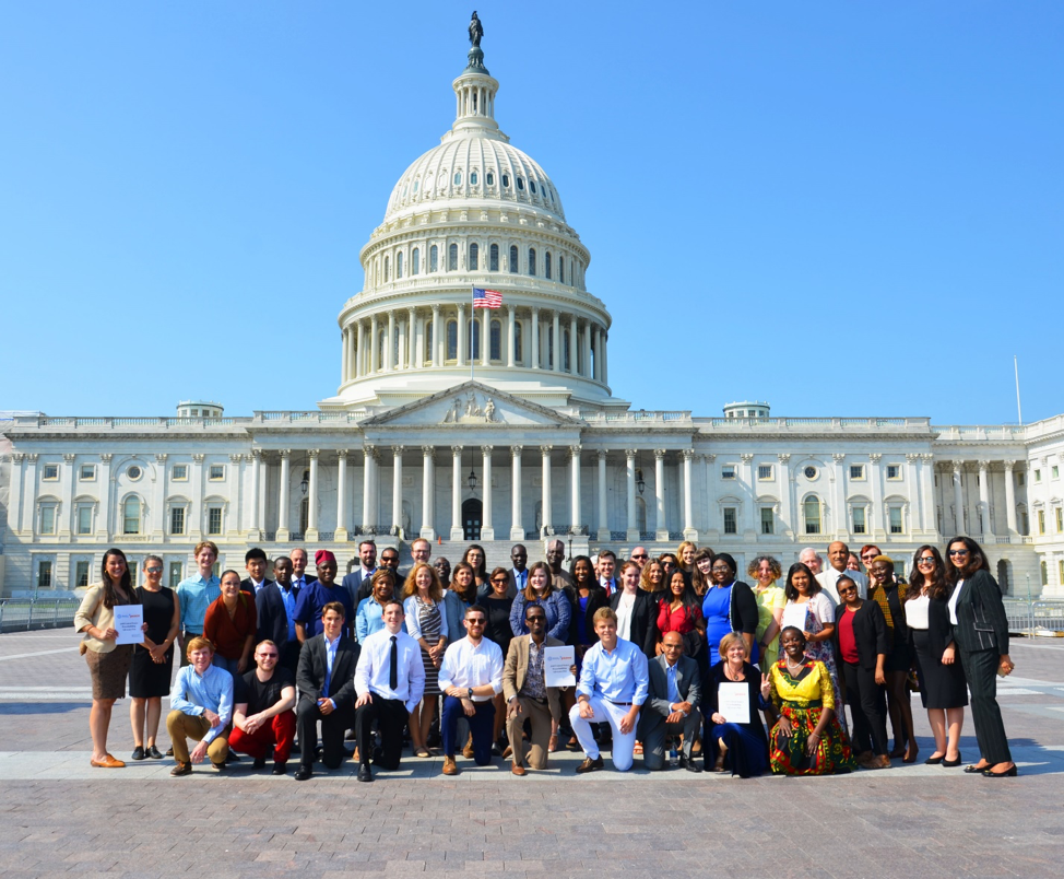 Group of students, capitol building behind them