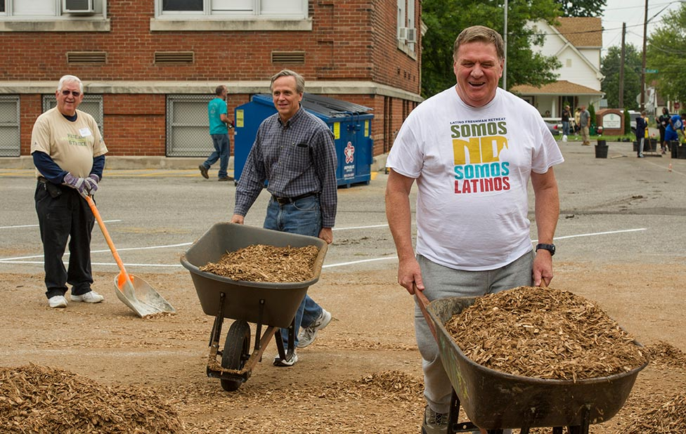 Notre Dame president Rev. John Jenkins, C.S.C., and Archbishop Joseph W. Tobin help out at the Alumni Association service project at Providence Cristo Rey High School