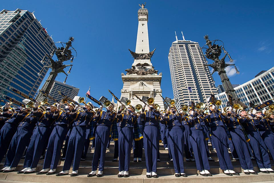 The Notre Dame Marching Band performs in front of Monument Circle for fans before the Shamrock Series game