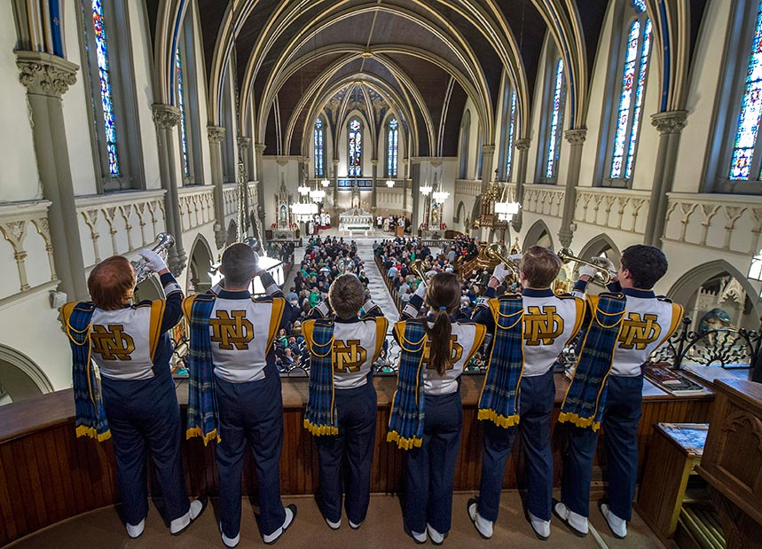 Trumpets from the Notre Dame Marching Band play the Alma Mater at the end of Mass at Saint John the Evangelist Catholic Church before the Shamrock Series game