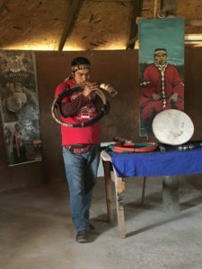 The indigene plays the traditional musical instrument