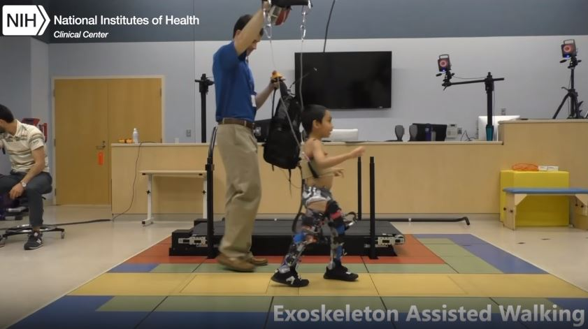 Patient using exoskeleton to aid his walking.
