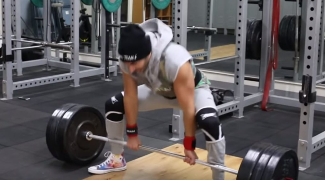 Gym BRO imitates/mocks powerlifters by wearing tons of lifting equipment for a deadlift