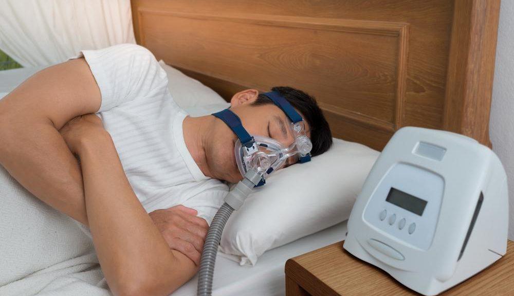Man sleeping while using CPAP machine