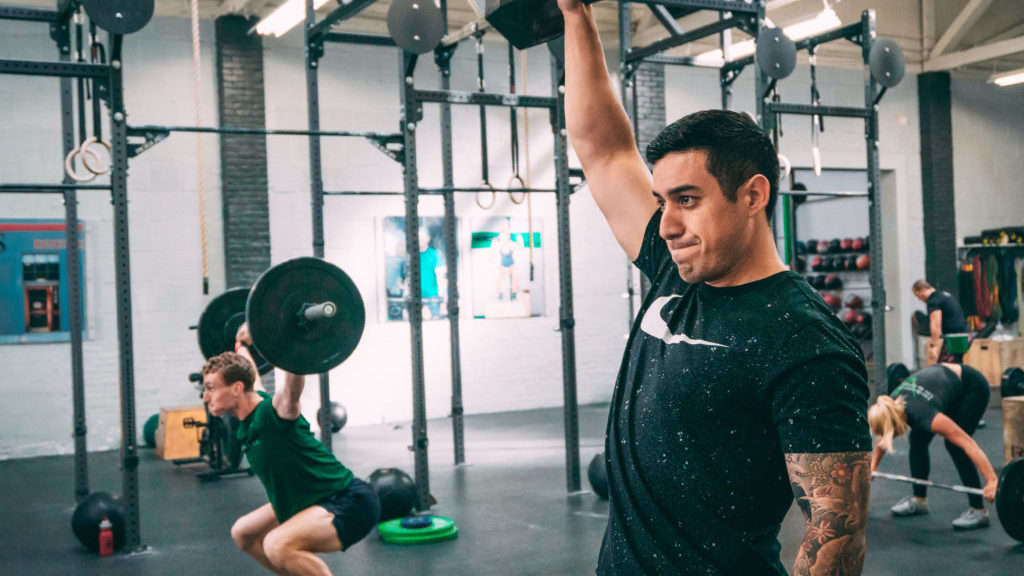 Athlete training only one half of his body using a single arm snatch movement