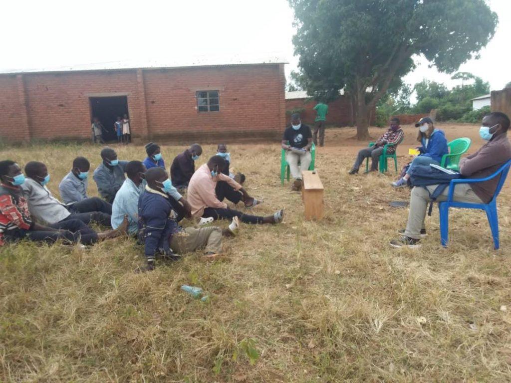 My classmates Arthur Ssembajja and Emily Kaplan observing a focus group led by facilitators Micter (left) and Moyenda (right) in Muluma, Chiradzulu.