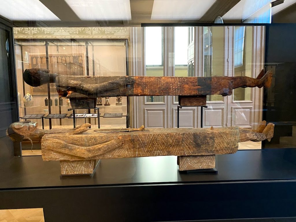 Two short and narrow ancient African coffins