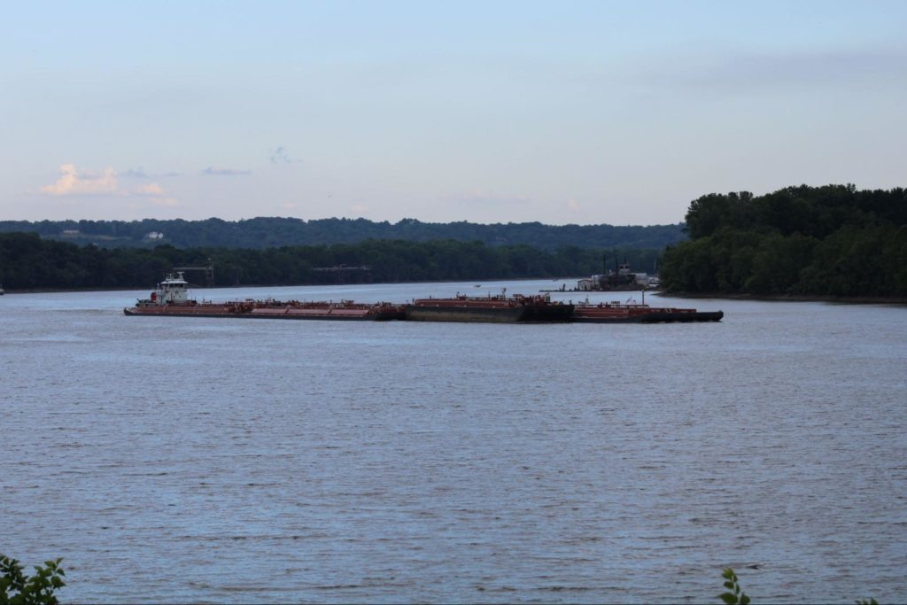 A large barge in a quiet Ohio river