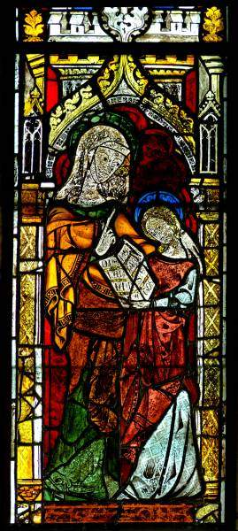 Image of stained glass window of Saint Anne teaching the Virgin Mary to read