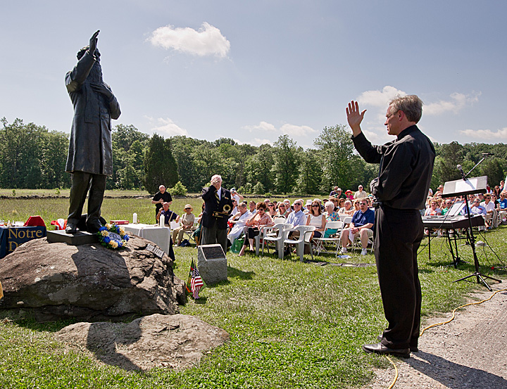 Fr. Jenkins blesses the statue.