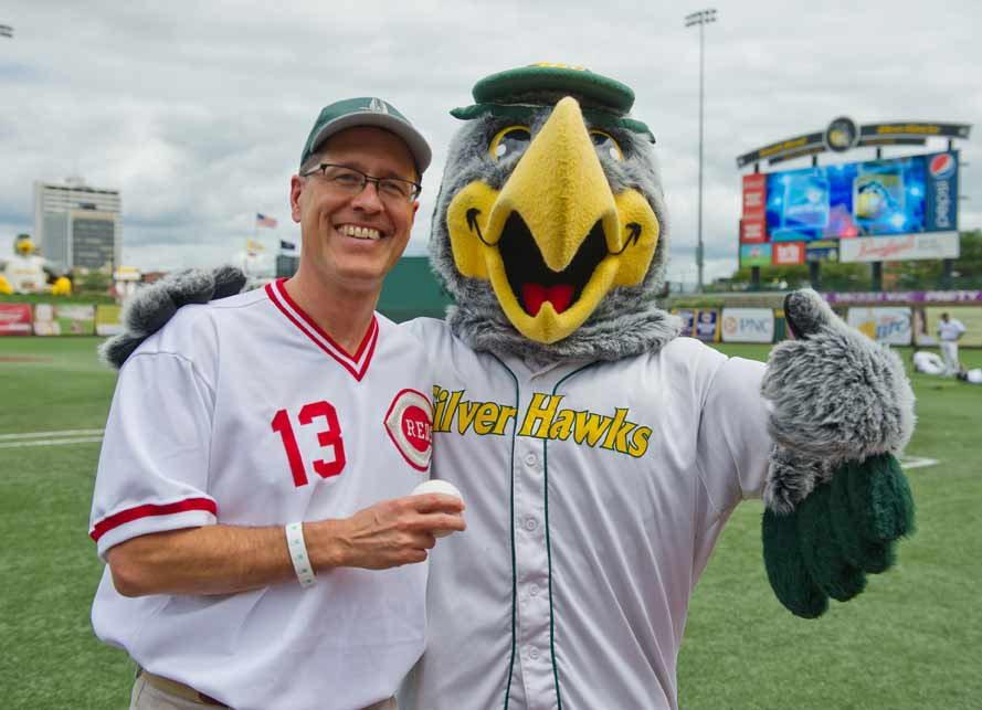 Jul. 29, 2013; Center for Social Concerns Director Rev. Paul Kollman poses with South Bend Silverhawks mascot Swoop after throwing out the ceremonial first pitch at a game at Coveleski Stadium. Photo by Matt Cashore/University of Notre Dame(click on image to purchase)