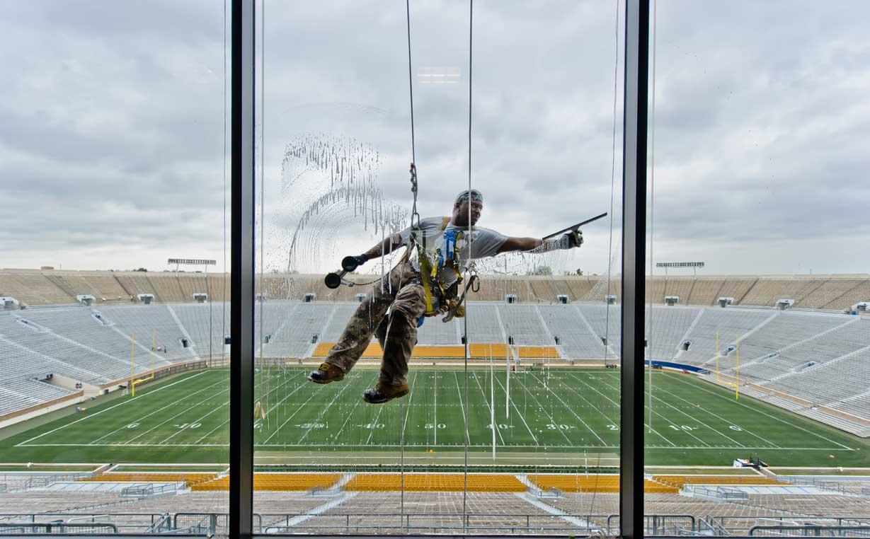 Aug. 22, 2013; Window washing in the ND Stadium press box. Photo by Matt Cashore/University of Notre Dame