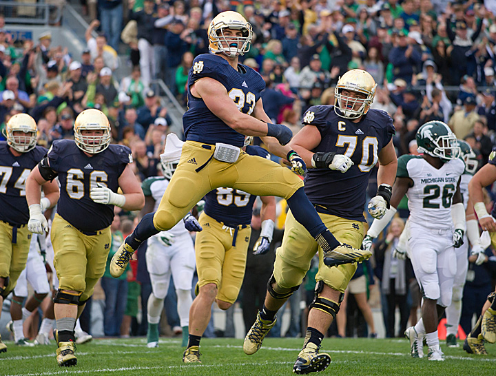 Cam McDaniel celebrates after his fourth quarter touchdown run.