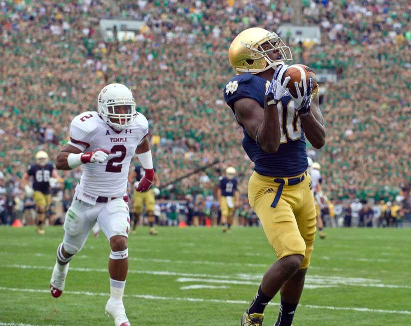 Aug. 31, 2013; DaVaris Daniels catches a pass for a touchdown against Temple. Photo by Matt Cashore