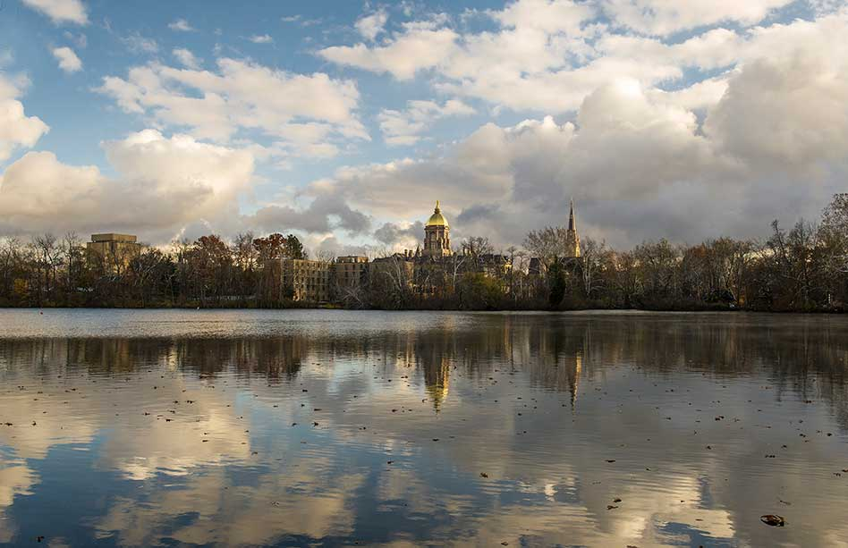 Nov. 12, 2013; St. Joseph Lake with the Basilica of the Sacred Heart and Main Building. Photo by Barbara Johnston/University of Notre Dame