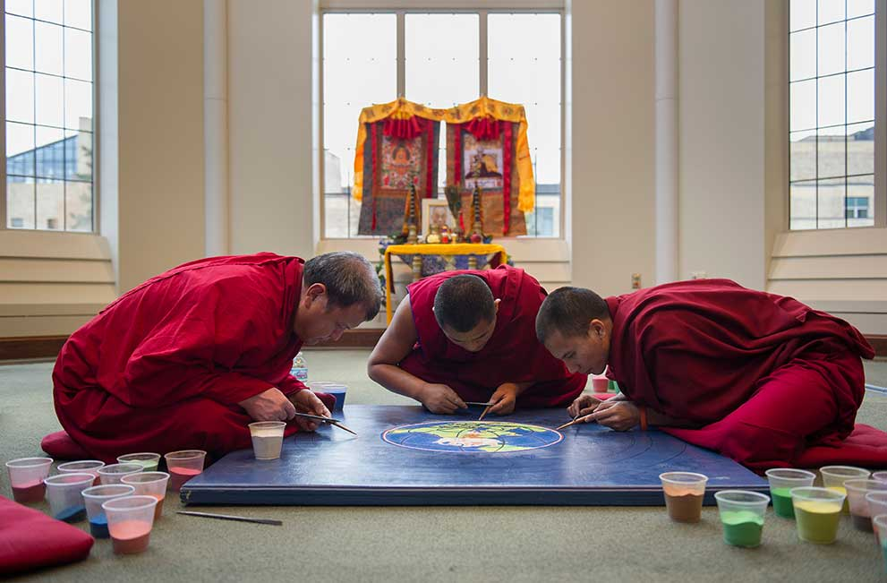 Nov. 18, 2013; Tibetan Buddhist monks construct a peace sand mandala in the Jordan Hall of Science Reading Room. The monks will be constructing the mandala, Monday through Thursday from 9:30 a.m. to 4:30 p.m.. Photo by Barbara Johnston/University of Notre Dame