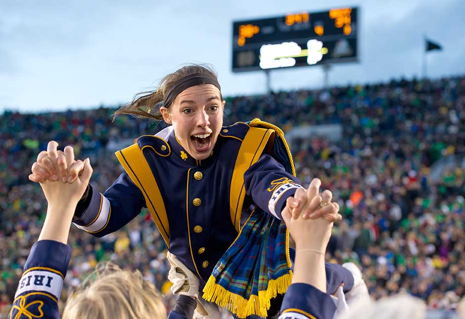 Nov. 2, 2013; Notre Dame Marching Band members celebrate after a touchdown during the Navy game, 2013. Photo by Matt Cashore