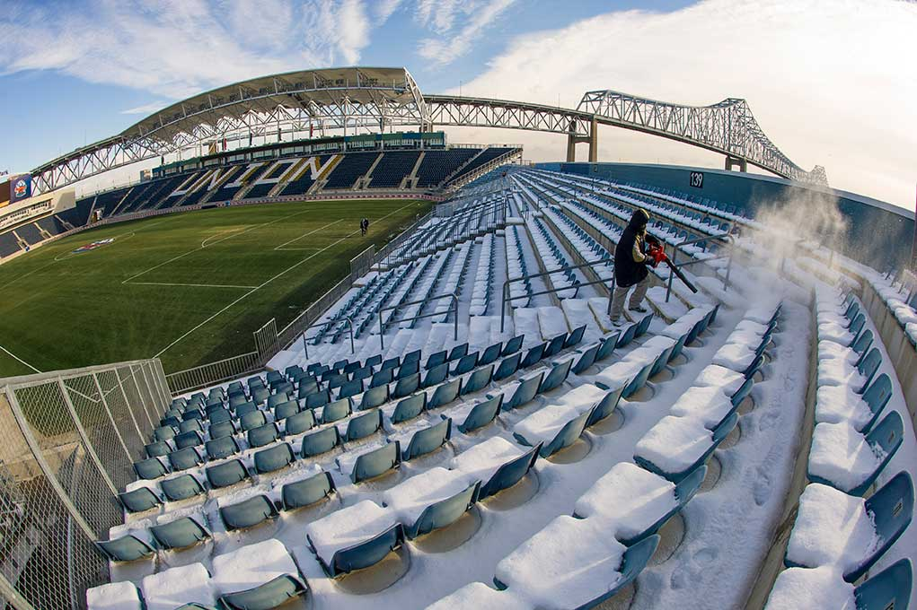 Dec 12, 2013; A stadium worker blows snow off the seats at PPL Park in Chester, Pa. Notre Dame men's soccer team will play against New Mexico tomorrow night in the semifinals of the NCAA Championship at the stadium. This season marks the program's first appearance in the College Cup. Photo by Barbara Johnston/University Photographer
