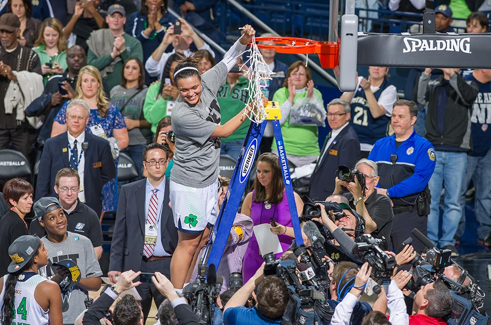 Mar 31, 2014; Kayla McBride (21) holds up the net after Notre Dame defeated the Baylor Bears in the regional final of the 2014 NCAA Tournament. Notre Dame won 88-69.