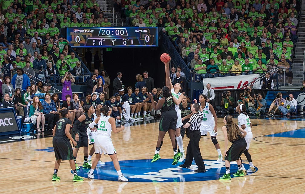 Mar 31, 2014; Natalie Achonwa (11) and Baylor Bears center Sune Agbuke (22) jump for the opening tip in the regional final of the 2014 NCAA Tournament. Notre Dame won 88-69.