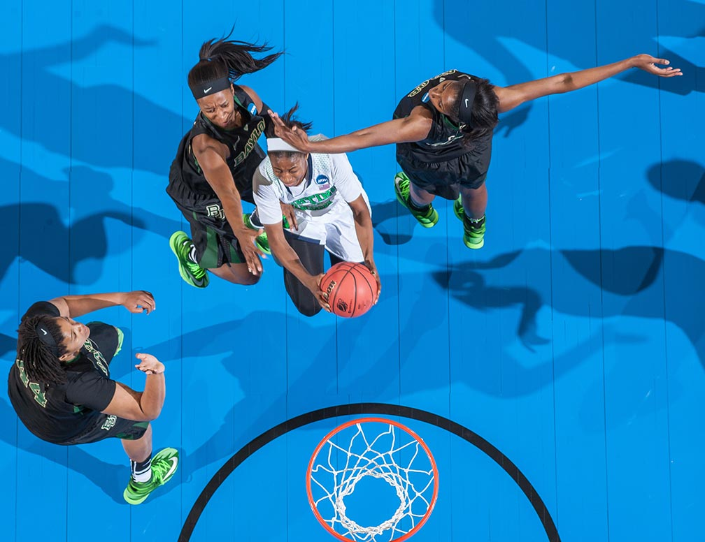 Mar 31, 2014; Jewel Loyd (32) goes up for a shot as Baylor Bears center Kristina Higgins (44) guard Ieshia Small (24) and center Khadijiah Cave (55) defend in the regional final of the 2014 NCAA Tournament. Notre Dame won 88-69.