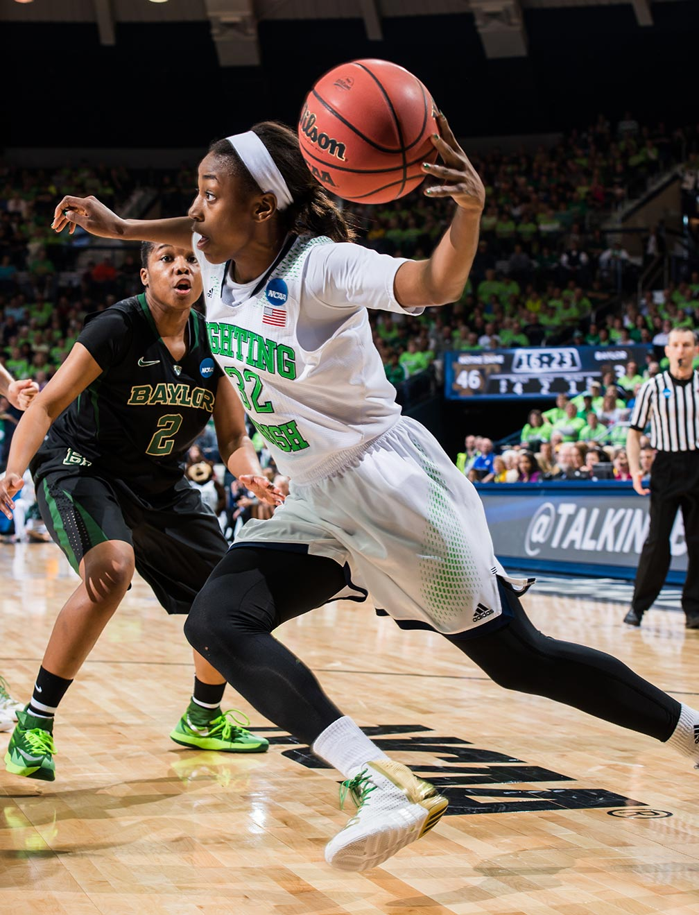 Mar 31, 2014; Jewel Loyd (32) drives to the basket as Baylor Bears guard Niya Johnson (2) defends in the regional final of the 2014 NCAA Tournament. Notre Dame won 88-69. Photo by Matt Cashore