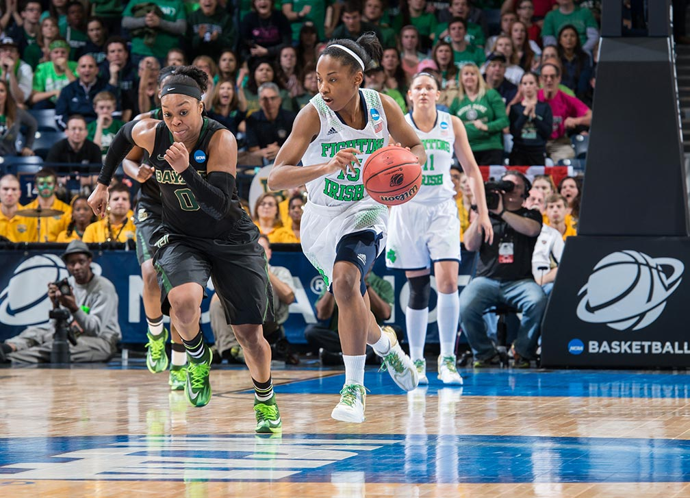 Mar 31, 2014; NLindsay Allen (15) dribbles as Baylor Bears guard Odyssey Sims (0) defends in the regional final of the 2014 NCAA Tournament. Notre Dame won 88-69. Photo by Matt Cashore