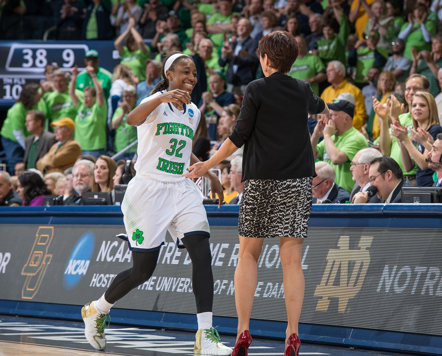 Mar 31, 2014; Jewel Loyd (32) hugs head coach Muffet McGraw as she leaves the game in the second half against the Baylor Bears in the regional final of the 2014 NCAA Tournament. Notre Dame won 88-69. Photo by Matt Cashore