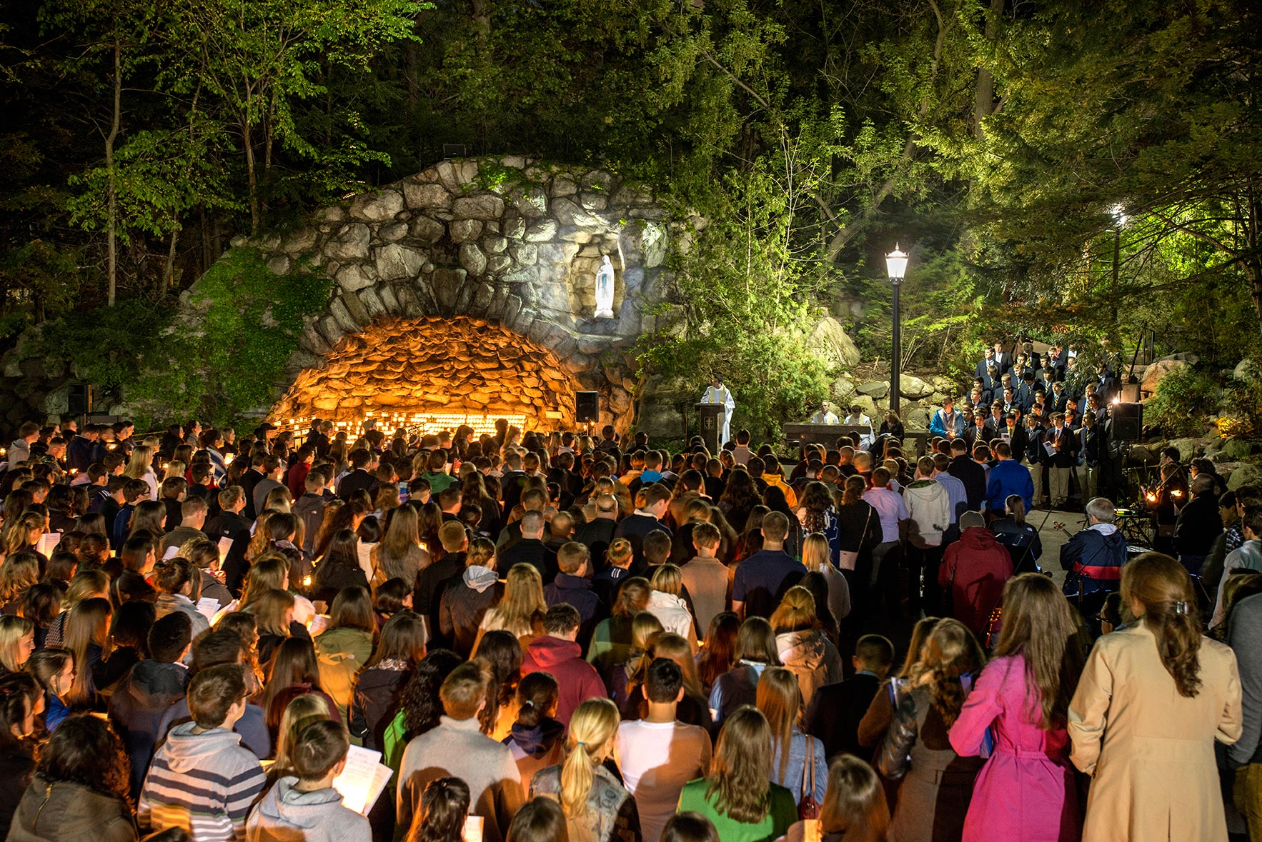 BJ - The seniors' last visit to the Grotto is my favorite Commencement event to shoot because it is visually beautiful and the emotional element is palpable. May 15, 2014; Seniors gather at the Grotto for their last visit before the 2014 Commencement. Photo by Barbara Johnston/University of Notre Dame