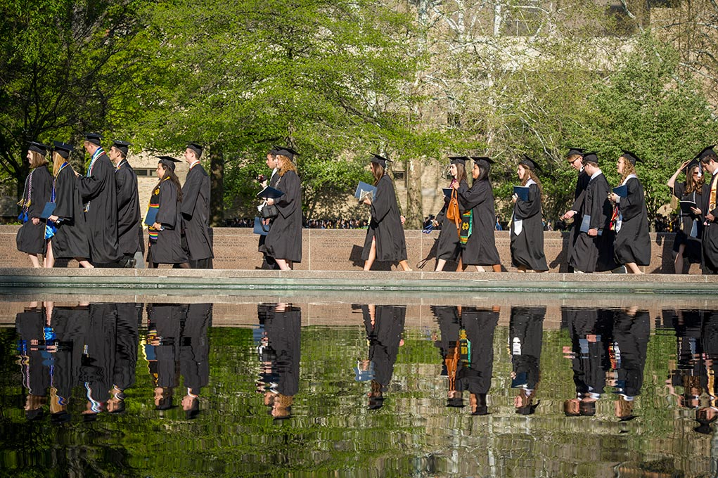 May 18, 2014; Graduates process along the reflective pond in front Hesburgh Library to Notre Dame Stadium for the 2014 Commencement ceremony. Photo by Barbara Johnston/University of Notre Dame