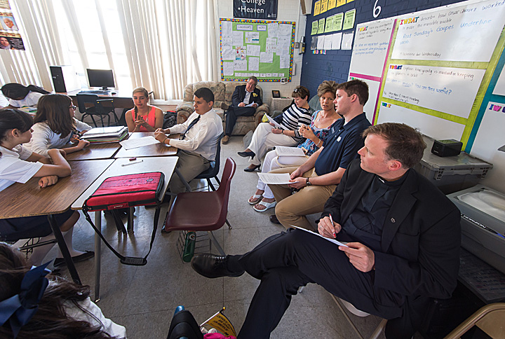 ACE advisory board members, including co-founder Fr. Sean McGraw, observe in the classroom of ACE teacher Linda Schoebel at St. John the Evangelist School in Tucson, Arizona, an ACE Academy.