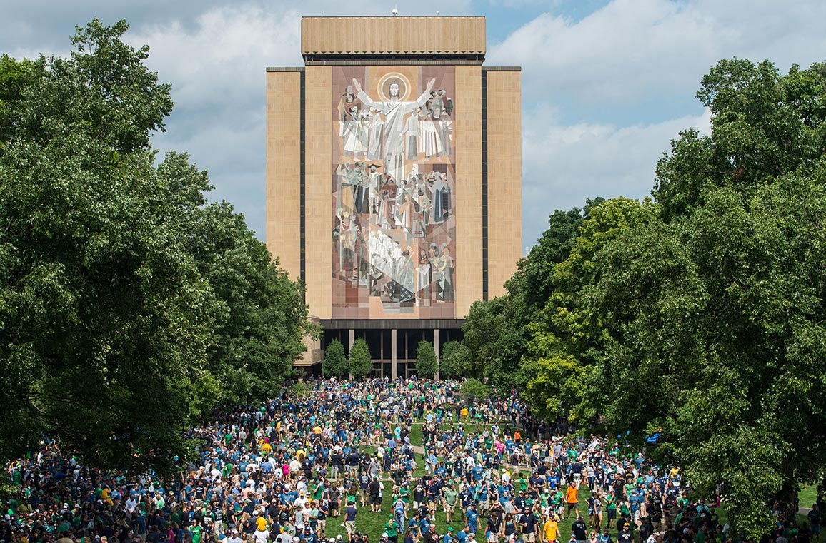 Fans crowd the library quad under the gaze of Touchdown Jesus. Photo by Matt Cashore